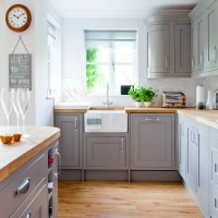 Country kitchen with grey painted cabinetry and wooden worktops