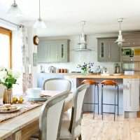 Spacious family kitchen with island and dining table