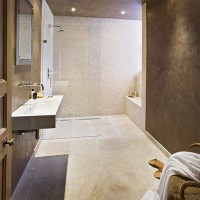 Modern spa bathroom with stone walls and floor
