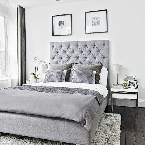 Modern Bedroom With Grey Upholstered Bed And Soft