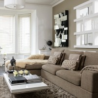 Neutral modern living room with beige sofa and mirror