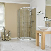 Neutral bathroom with curved corner shower cubicle