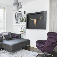 Modern white living room with grey and purple seating