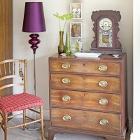 Vintage bedroom storage with purple lamp
