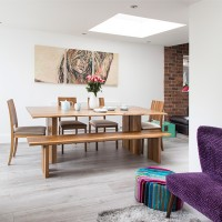 Smart dining area with bench seating and skylight