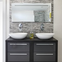 Monochrome bathroom with vanity unit and basins