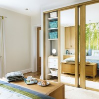 Neutral bedroom with built-in mirrored wardrobe