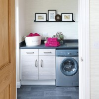 Traditional utility room with washing machine and cabinetry