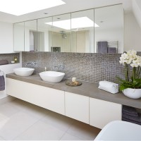 White modern bathroom with grey mosaic tiles and twin basins
