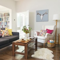 Contemporary white living room with colourful soft furnishings