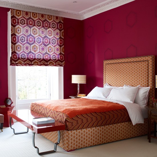 Romantic Bedroom With Deep Red Walls And Orange Upholstery Romantic Bedroom Ideas