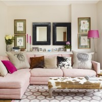 Traditional living room with pink sofa and animal-print footstool