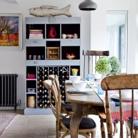 Dining room with pigeonhole display and wooden furniture