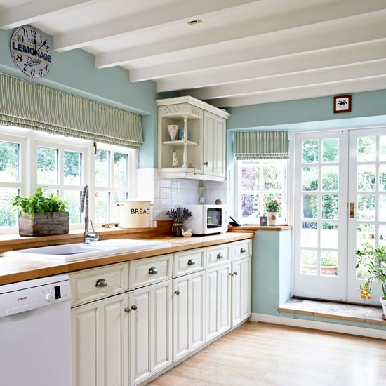 Ice blue country kitchen with cream cabinetry - Light blue and white kitchen ...