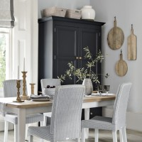 Pale grey dining room with smart black storage