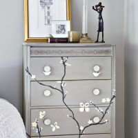 Bedroom storage with home-painted cherry-tree motif