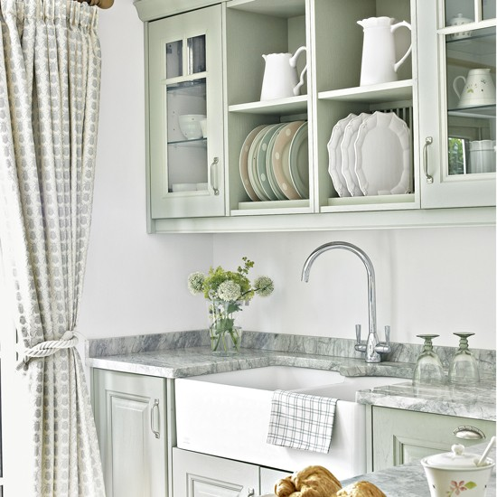 Country Kitchen With Green Cabinetry And Open Shelves