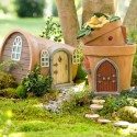 See what mischief the elves are up to behind these amazing fairy doors in the garden