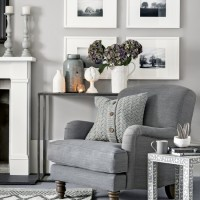 Warm light-grey living room with cosy armchair and knitted cushion