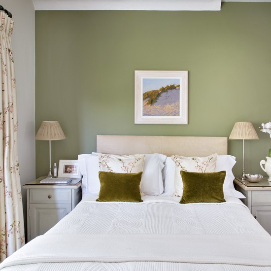 pretty bedroom with olive green feature wall housetohome