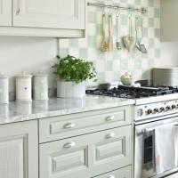 Pale green kitchen with chequerboard splashback