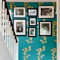 Bright cheerful hallway with turquoise wallpaper and picture gallery