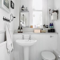 White bathroom with panelling and quirky details