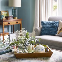 Traditional living room with blue walls and tea tray