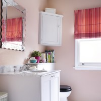 Traditional bathroom with pale-pink walls and striped blind