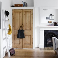 Bedroom with built-in wardrobe and fireplace