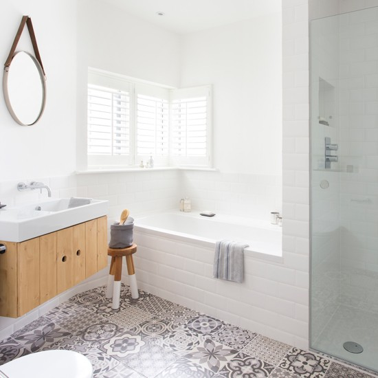 bright white bathroom with patchwork floor tiles