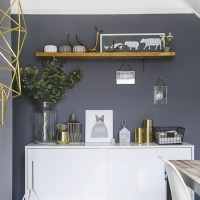 Grey dining room with white sideboard and open shelving