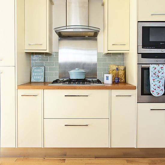 Modern cream kitchen with duck egg metro tiles for Cream kitchen with black tiles