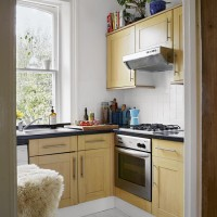 Classic compact kitchen with wooden cabinetry
