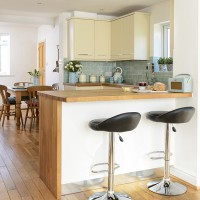Family kitchen with breakfast bar and wooden worktops