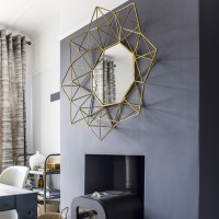 Dining room fireplace with gold feature mirror