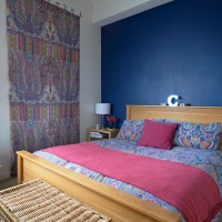 Blue modern bedroom with fabric wall panel