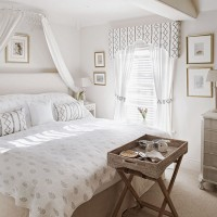 Traditional white bedroom with canopy and tray table