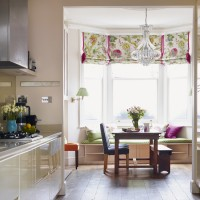 Traditional kitchen-diner with floral blind and dining set
