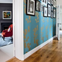 Modern hallway with feature wallpaper and photo display