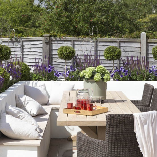 Garden corner seating take a tour of this arts and for Terrace seating ideas