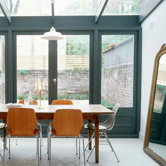 Modern conservatory with gun metal window frames small for Conservatory dining room design ideas