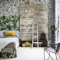 Tropical-themed bedroom with monochrome wallpaper