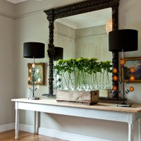Hallway with long console table and feature mirror