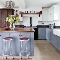 Powder blue kitchen with bar stool breakfast bar