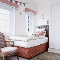 Pretty bedroom with alcove bed and pelmets
