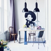Modern dining room with grey pendants and framed print