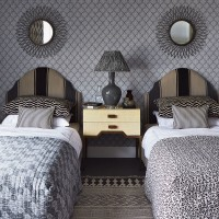 Grey twin bedroom with multi patterned symmetry