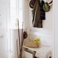 Country hallway with painted bench and peg storage