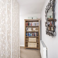Neutral hallway with smart tree-design feature wall